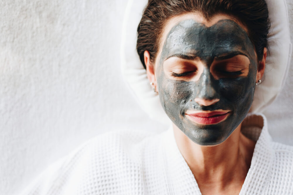 Woman with charcoal mask