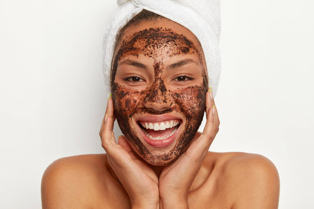 Woman with exfoliating mask