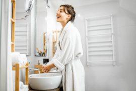 Woman at sink in bathroom