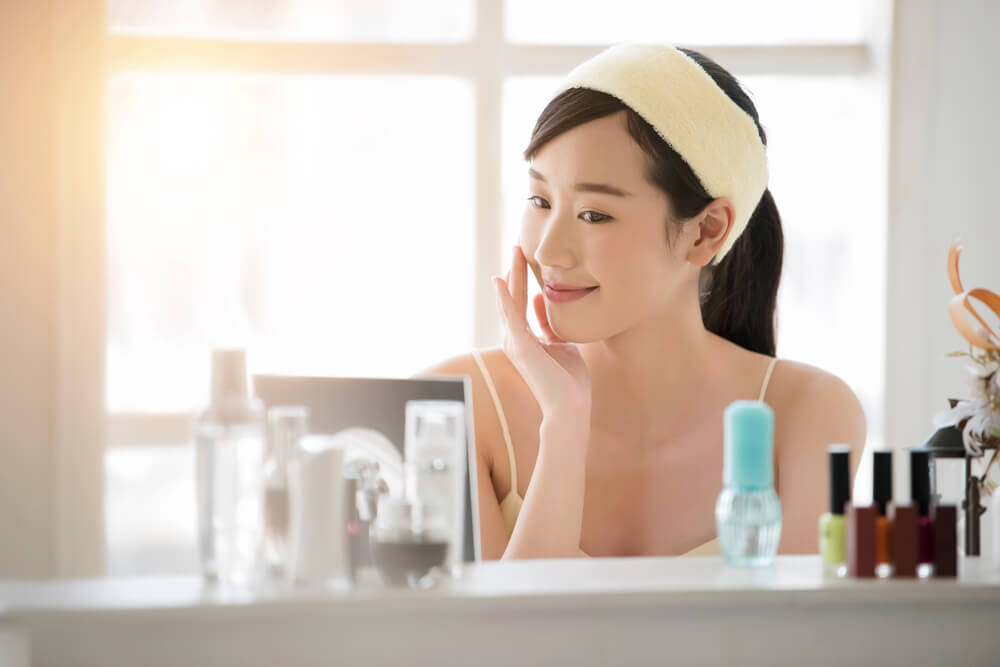 Woman looking at skincare products