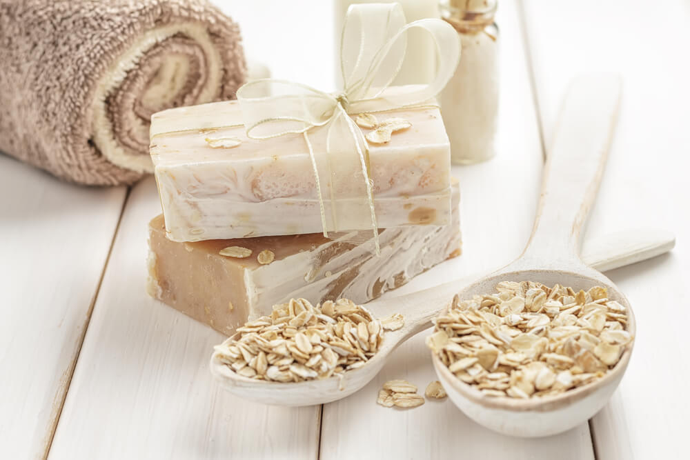 Oats in bowl with soap and towel