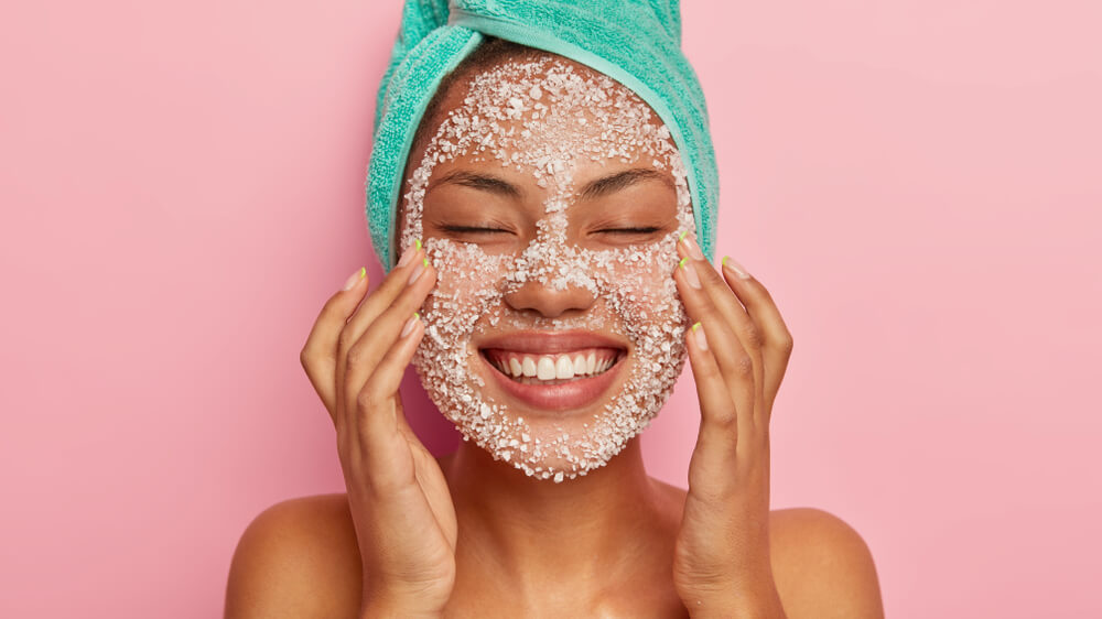 Woman with face scrub