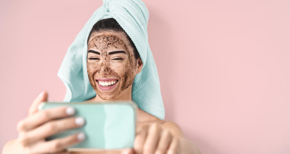 Woman taking selfie of exfoliated face