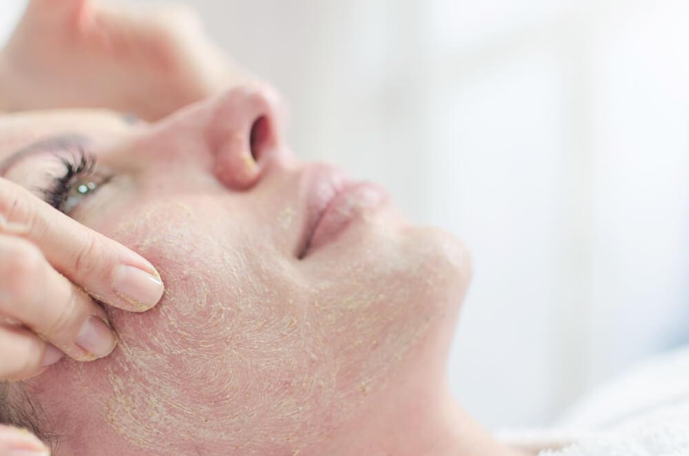 Woman having face treatment
