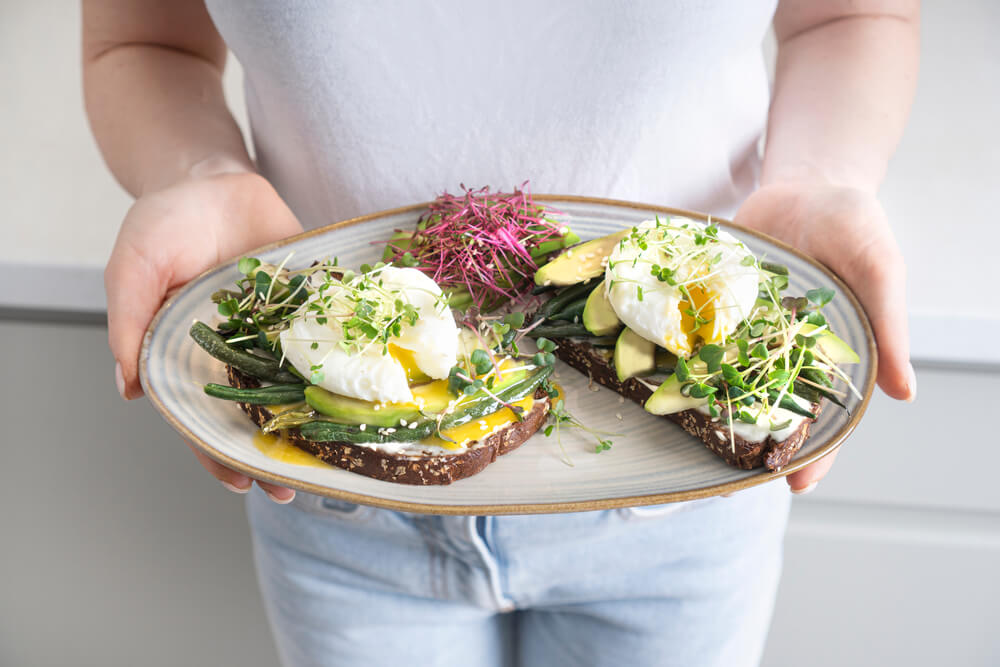 Microgreens and other food on plate