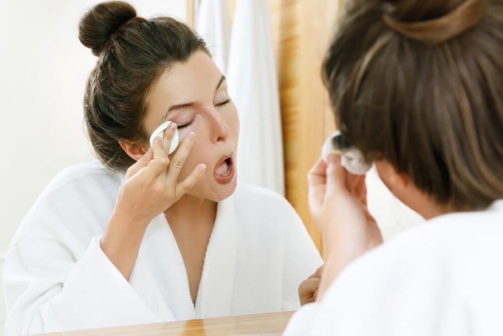 Woman removing mascara