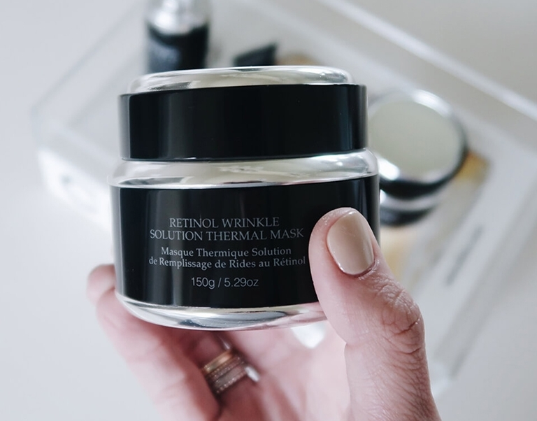 Blogger So Sage holding Retinol Wrinkle Solution Thermal Mask